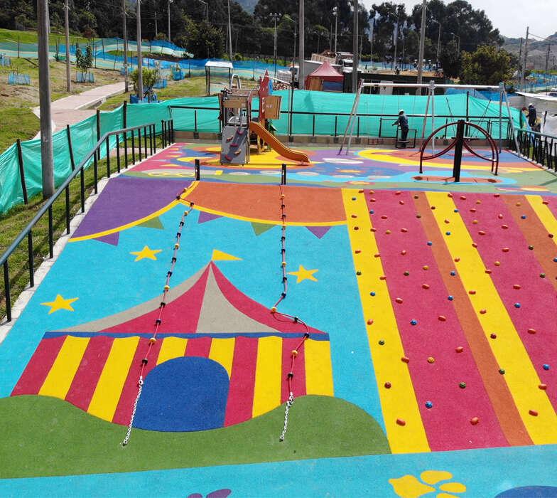 Parque-infantil-nuevo-milenio-bogota-juegos-infantiles-piso-caucho