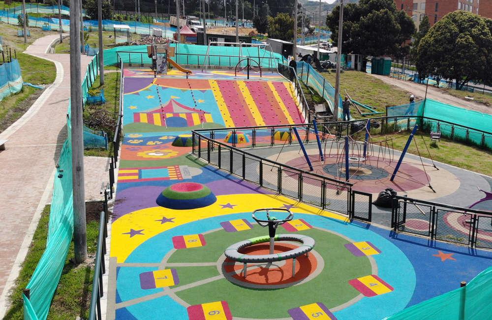 Parque-infantil-nuevo-milenio-bogota-juegos-infantiles-piso-caucho-EPDM
