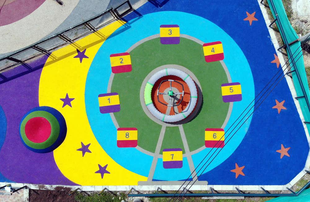 Parque-infantil-nuevo-milenio-bogota-juegos-infantiles-piso-caucho-EPDM-stellanova